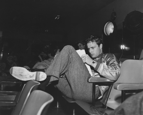 "Marlon Brando on the set of ""A Streetcar Named Desire"" Studying his lines for the next day"