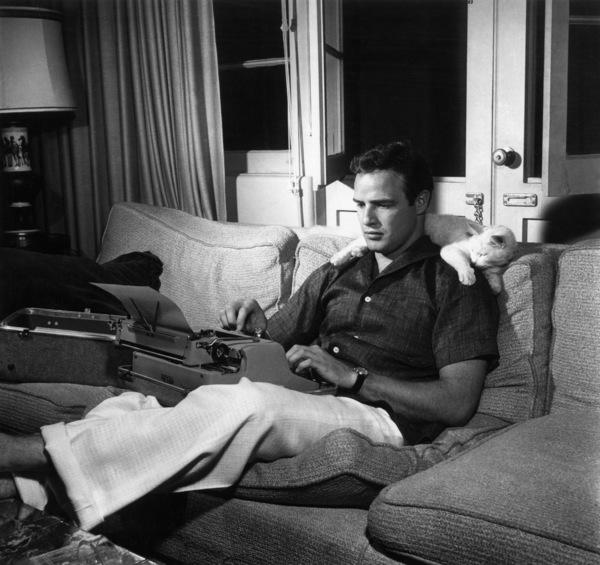 Marlon Brando at home with his pet catcirca 1956 - Image 0007_0317