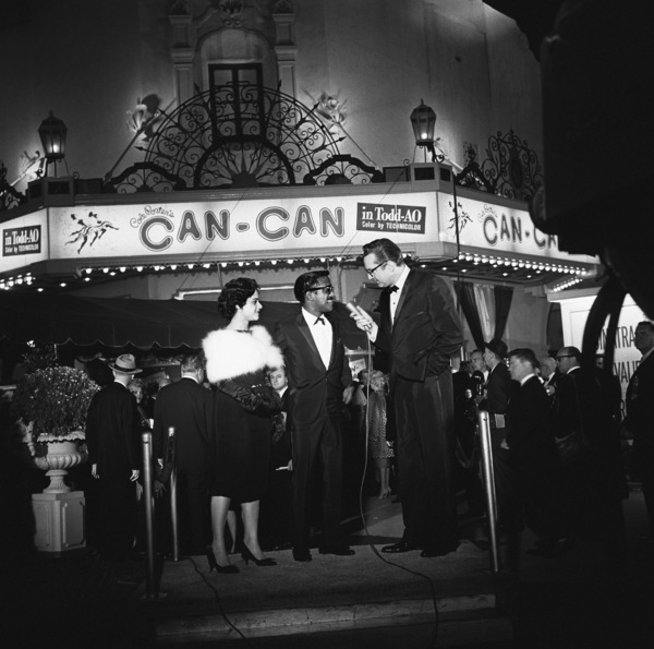 """Sammy Davis Jr. with his sister, Sandy Davis, at the Hollywood premiere of """"Can-Can"""" being interviewed by Steve Allen1960© 1978 Sid Avery - Image 0009_0011"""