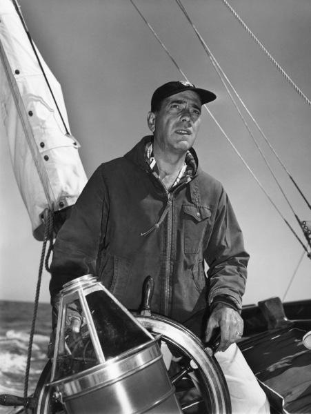 "Humphrey Bogart at the helm of his yacht ""Santana""1952© 1978 Sid Avery - Image 0015_0003"