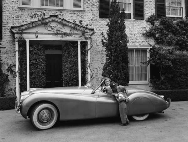Humphrey Bogart, Lauren Bacall and their son, Stephen, in their Jaguar XK 120 at home in Los Angeles, CA1952© 1978 Sid Avery - Image 0015_0007