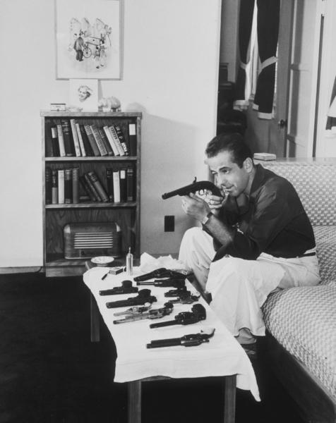 Humphrey Bogart with his gun collection at home, circa 1946.MPTV - Image 0015_1047