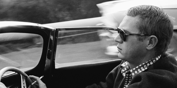 Steve McQueen driving his 1957 XK-SS Jaguar through Nichols Canyon in Hollywood1960© 1978 Sid Avery - Image 0019_0311