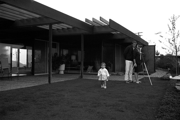 Steve McQueen at home on Solar Drive in the Hollywood Hills, with wife Neile and daughter Terry1960© 1978 Sid Avery   - Image 0019_1009