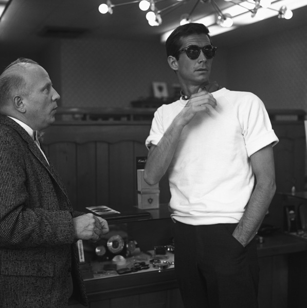 Anthony Perkins trying on sunglasses1959© 1978 Sid Avery - Image 0032_0081