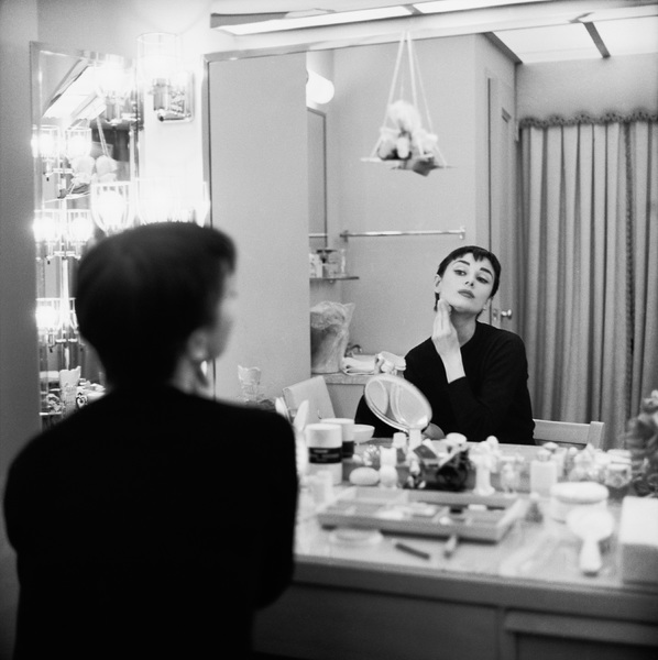 "Audrey Hepburn is her dressing room during the filming of ""Sabrina""1953© 2000 Mark Shaw - Image 0033_0089"