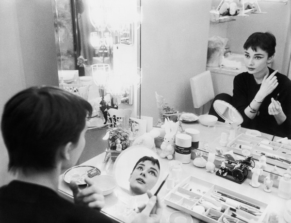 "Audrey Hepburn is her dressing room during the filming of ""Sabrina""1953© 2000 Mark Shaw - Image 0033_2379"
