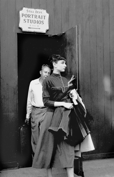 Audrey Hepburn and photographer Bud Fraker leaving the studio1953 © 1978 Bob Willoughby - Image 0033_2498