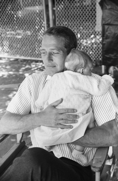 Paul Newman with his baby daughter, Claire, at home in Hollywood1965© 1978 David Sutton - Image 0070_2316