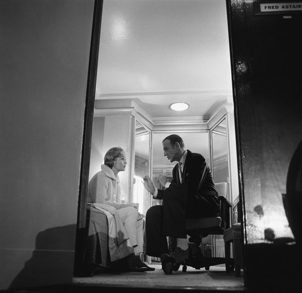 """Debbie Reynolds talking with Fred Astaire in his dressing room during a break in filming """"The Pleasure of His Company"""" 1960 © 1978 Sid Avery - Image 0071_0011"""