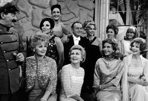 Bob Hope with Jerry Colonna and all of his leading ladies:left to right- (Back row) Joan Collins, Dorothy Lamour, Virginia Mayo, Vera Miles, Janis Paige(front row) Lucille Ball, Joan Fontaine, Hedy Lamarr and Signe Hasso, circa 1961.Photo by Gerald Smith / MPTV - Image 0173_0514