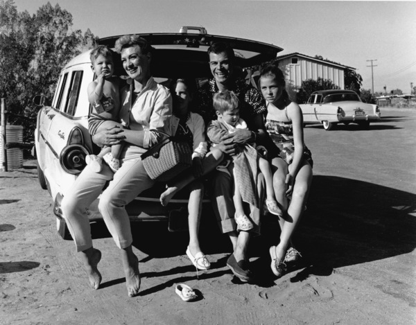 Eve Arden, husband Brooks West and family on the tailgate of their station wagon1956 © 1978 Sid Avery - Image 0287_0013