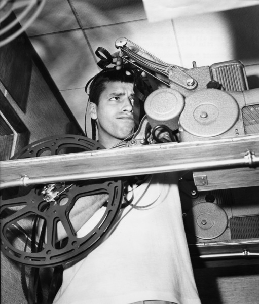 """After working all day in """"The Stooge"""" at Paramount, Jerry Lewis goes home to pursue his hobby of home-movies and proceeds to get all tangled up while trying to thread the film into his equipment1951** I.V. / M.T. - Image 0292_0604"""