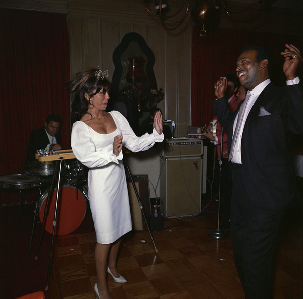 Nancy Sinatra dancing with George Jacobs at Chasen