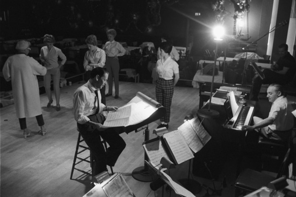 Frank Sinatra going over the songs for the Sands show in evening, while the choreographer puts the dancers through the new routines1960 © 1978 Bob Willoughby - Image 0337_2356