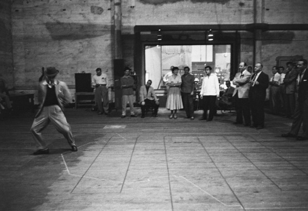 Gene Kelly improvises as Betty Comden, Adolph Green, Andre Previn, Michael Kidd, Johnny Green, Arthur Freed and Stanley Donen look on1954© 1978 Bob Willoughby - Image 0538_1042