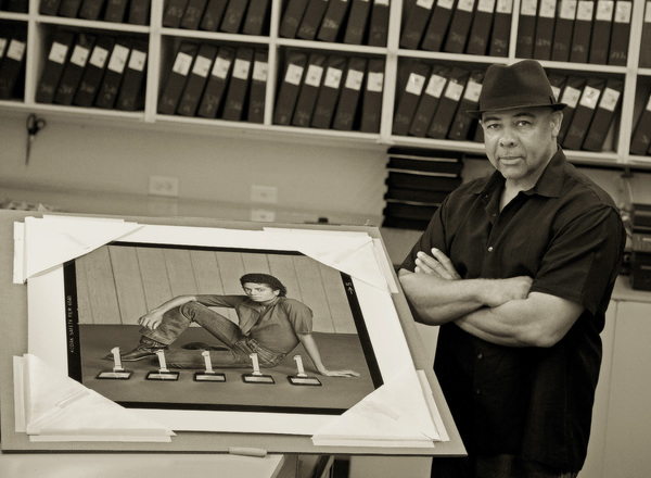 Photographer Bobby Holland posing with one of his most iconic photos of Michael Jackson2017© 2017 Andrew Howick - Image 0628_0203