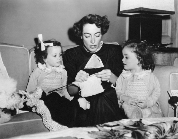 Joan Crawford knitting with her twin daughters Cindy and Cathycirca 1950 - Image 0728_2108