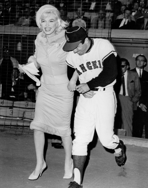 Marilyn Monroe runs onto Chavez Ravineaccompanied by Angels outfielder Albie Pearson.She made a plea for donations to the MuscularDistrophy fund in pre-game ceremonies. 6/1/62. - Image 0758_0541