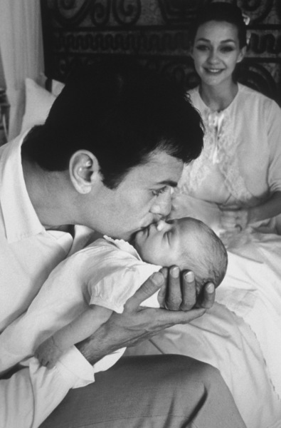 Tony Curtis kissing his new daughter Alexandra as wife Christine watches proudly1964 © 1978 Bob Willoughby - Image 0845_0572