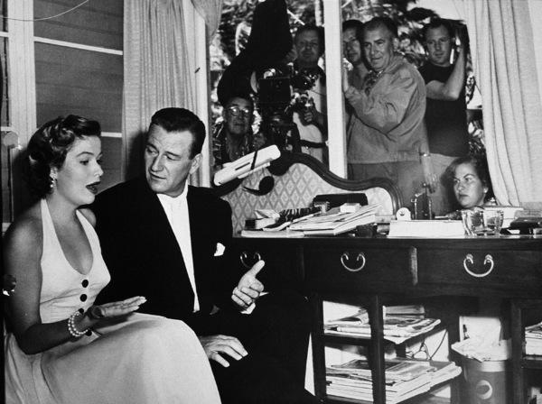 "John Wayne and Nancy Olson during the filming of ""Big Jim McLain,"" Warner Bros. 1952. - Image 0898_0008"