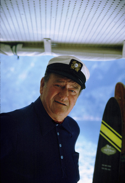 "John Wayne on his yacht, ""Wild Goose,"" 1971. © 1978 David Sutton - Image 0898_3087"