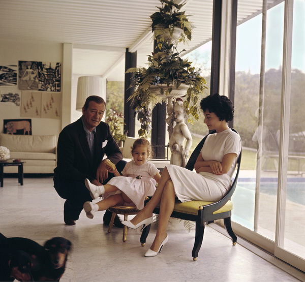 John Wayne with his daughter Aissa and wife Pilar at home on Louise Street in Encino, California1958 © 1978 Bernie Abramson - Image 0898_3117