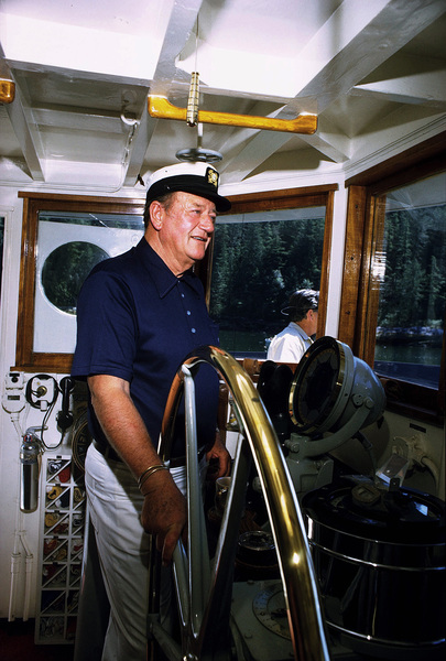 "John Wayne on his yacht, ""Wild Goose,"" 1971. © 1978 David Sutton - Image 0898_3133"