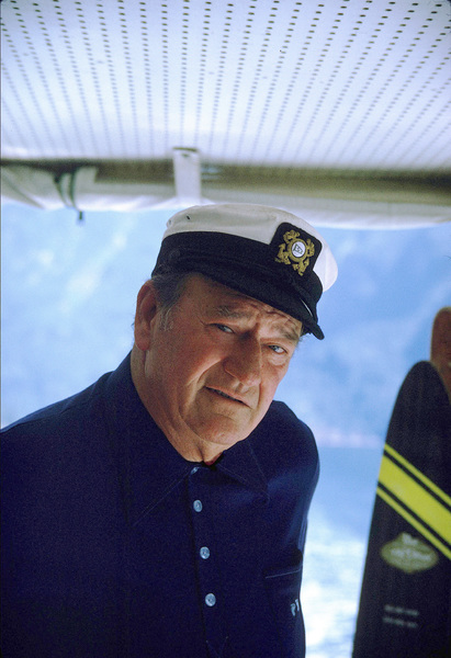 "John Wayne on his yacht, ""Wild Goose,"" 1971. © 1978 David Sutton - Image 0898_3241"