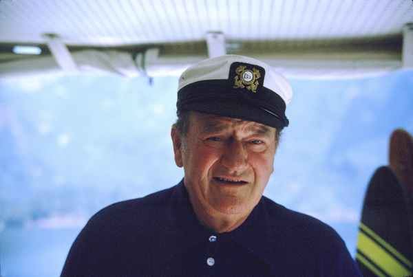 "John Wayne on his yacht, ""Wild Goose,"" 1971. © 1978 David Sutton - Image 0898_3243"