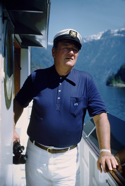 "John Wayne on his yacht, ""Wild Goose,"" 1971. © 1978 David Sutton - Image 0898_3245"