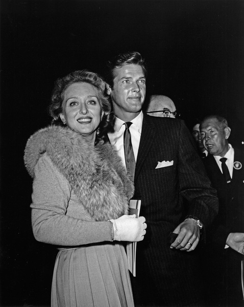 "Roger Moore escorting Celeste Holm to the premiere of ""Sunrise at Campobello""1960Photo by Joe Shere - Image 0963_0052"