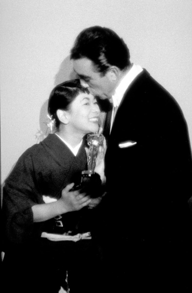 """Academy Awards: 30th Annual,"" Miyoshi Umeki and Anthony Quinn. 1958. © 1978 Sid Avery - Image 10764_0011"