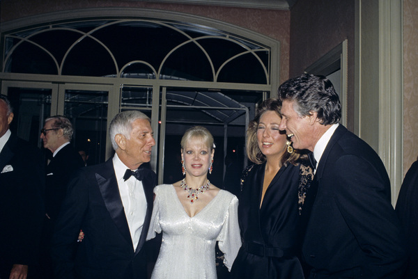 Aaron Spelling with his wife Candy, and Nolan Miller and his wife, at a Nolan Miller fashion show1988 © 1988 Gunther - Image 11502_0021