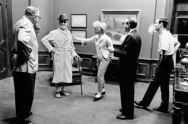 """""""Can-Can""""Director Walter Lang, Shirley MacLaine, producer Jack Cummings and Louis Jourdan amused by the vision of Maurice Chevalier appearing in his bathrobe1960 20th Century Fox © 1978 Bob Willoughby  - Image 1260_0044"""