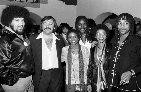 Norman Whitfield, Mike Luska, Maxine Waters, Julia Waters, Levi Ruffin Jr., Rick James at a party1979 © 1979 Bobby Holland - Image 23841_0004