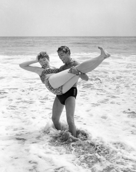 Shirley MacLaine and Steve Parker in the surf outside their Malibu front door 1955** B.D.M. - Image 24293_0087