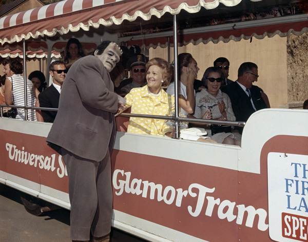 "Pat Nixon with the Frankenstein monster while she rides on a ""Glam Tram"" at Universal Studios Tourcirca 1969** B.D.M. - Image 24293_0977"