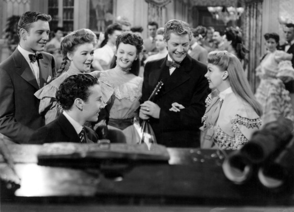 "Tom Drake, Lucille Bremer, Henry H. Daniels, Jr. and Judy Garland in ""Meet Me in St. Louis""1944 MGM** B.D.M. - Image 24293_1762"