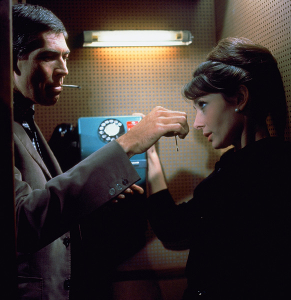 "James Coburn and Audrey Hepburn in ""Charade""1963 Universal** B.D.M. - Image 24293_2671"