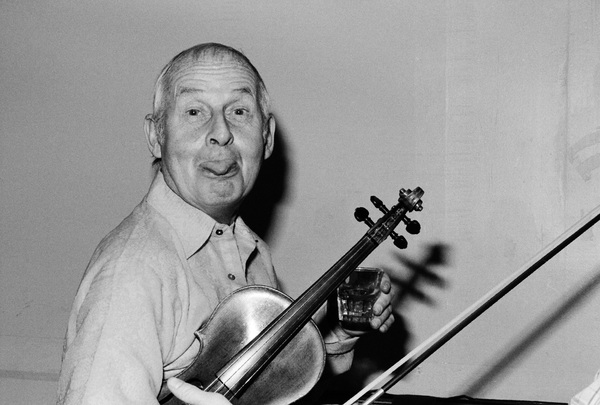 Stephane Grappelli photographed in the dressing room of a Long Island club named