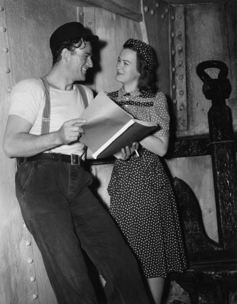 """John Wayne taking a dialect lesson from Osa Massen for his role in """"The Long Voyage Home""""1940 UA© 1978 Ned Scott Archive - Image 24327_0038"""