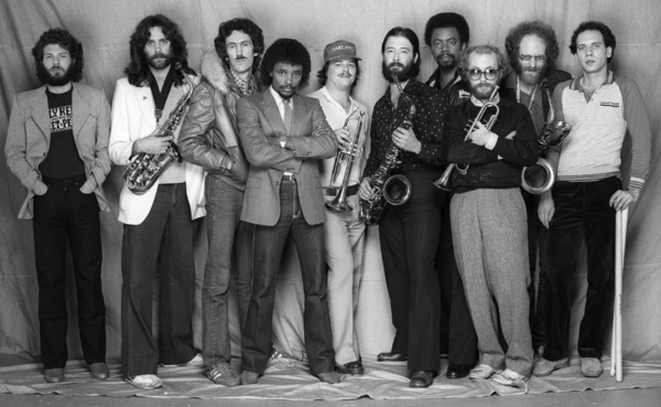"Tower of Power (Bruce Conti (guitar), Lenny Pickett (tenor sax), Greg Adams (trumpet), Mic Gillette (trumpet and trombone), Steven ""The Funky Doctor"" Kupka (baritone sax), Emilio Castillio (tenor sax), Dave Garibaldi (drums), Francis Rocco Prestia (bass), Brent Byars (percussion), Chester Thompson (Hammond organ))circa mid 1980s© 1980 Bobby Holland - Image 24331_0271"