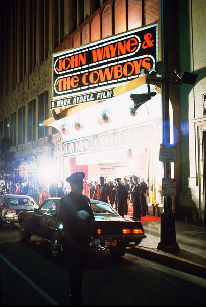 """""""The Cowboys,"""" John WayneWarner Bros. 1972.The theater marquee at the premiere. © 1978 David Sutton - Image 3370_0621"""