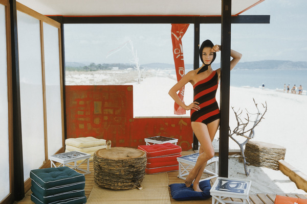Model Irene poses in a one shouldered maillot in a Japanese style beach cabana that was located at St. Tropez
