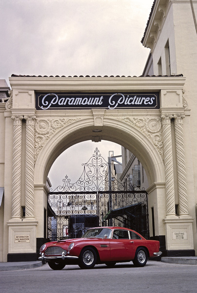 An Aston Martin DB5 parked in front of Paramount Studio