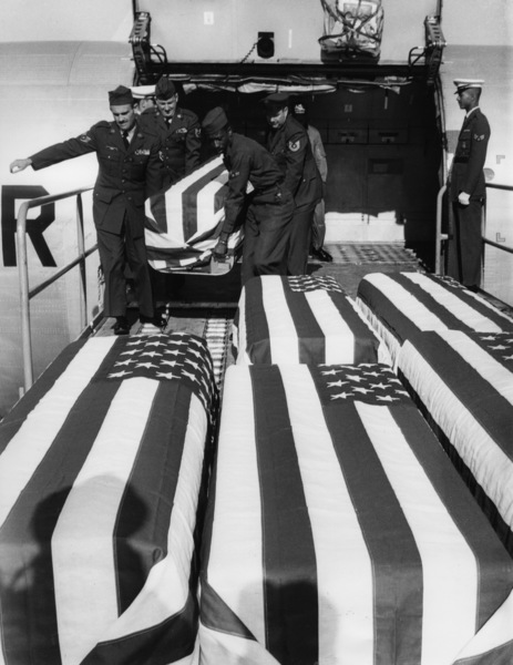 (Vietnam) Flag-draped caskets containing the bodies of nine U.S. servicemen killed in South Vietnam are unloaded at the Travis Air Force Base in CaliforniaFebruary 1965 - Image 4369_0013