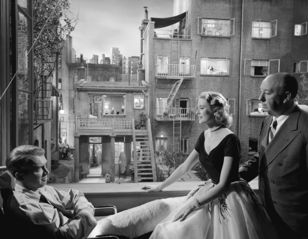 """James Stewart, Grace Kelly, and director Alfred Hitchcock on the set of """"Rear Window""""1954** I.V. - Image 5375_0019"""