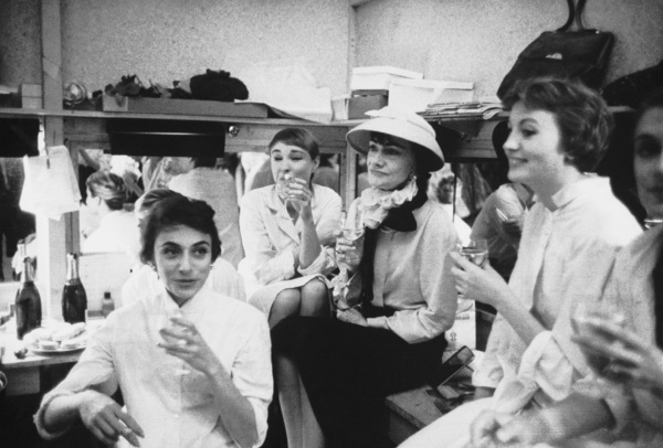 Coco Chanel drinks with her besmocked mannequins at traditional champagne party held after first showing of new fall and winter collection1957 © 2000 Mark Shaw - Image 5970_0020