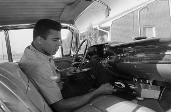 Cassius Clay in his 1960 Cadillac outside of his Louisville, Kentucky home 1963 © 1978 Gunther - Image 7683_0450